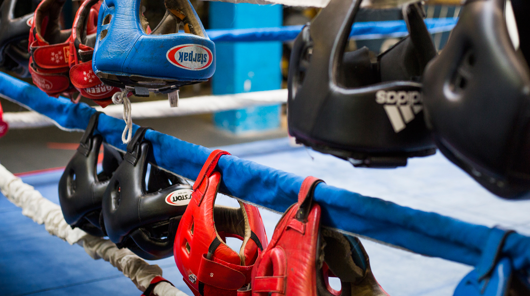 Boxing equipment hanging on ringside ropes