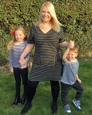Emma Conway smiling with her two children