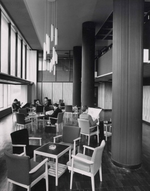 Male students sitting in a common area in High Hall in the 1960s, with many chairs around tables with ashtrays