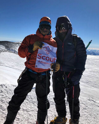 Jack Garner (right) and guide Paul Etheridge climbing Mount Elbrus