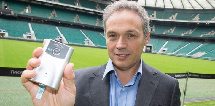 Professor Tony Belli, holding a prototype portable saliva test