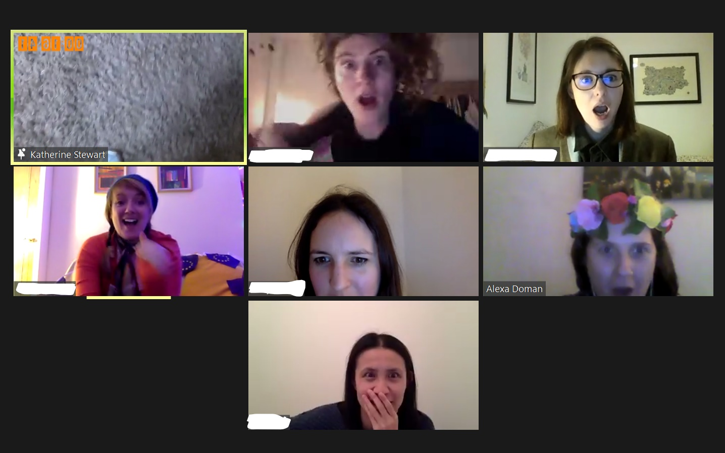 seven friends on a zoom call looking shocked