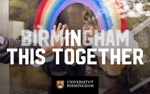 Woman touching hands with a visitor through a window, under a painted rainbow and the words Birmingham In This Together