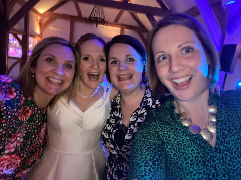 Four friends at a wedding