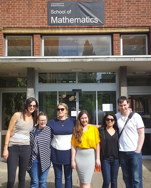 Six friends outside of the School of Mathematics