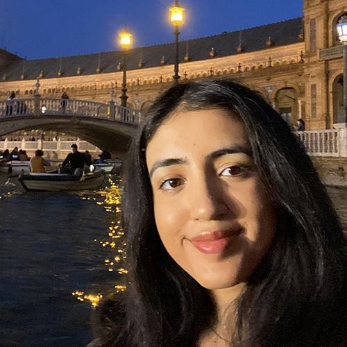 Sarina in front of bridge at night